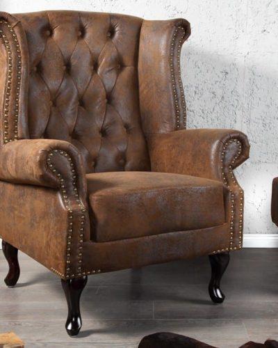 fauteuil-chesterfield-a-oreilles-en-coloris-marron-look-antique.jpg