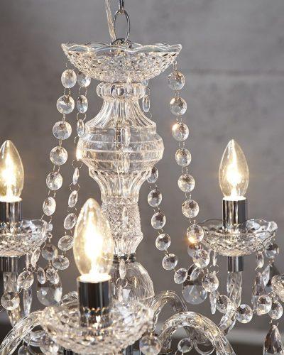lustre-transparent-suspendue-avec-5-bougies-1.jpg